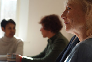 Group of 3 women discussing a website