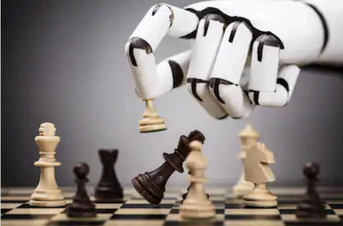 Image of a robotic hand making a chess move
